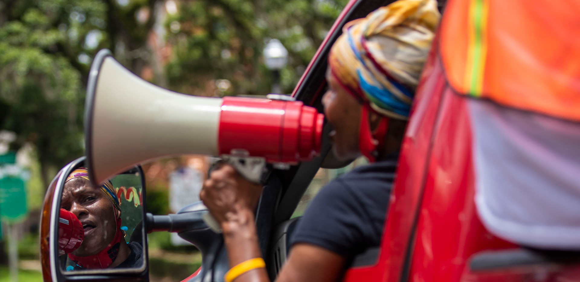 Trish Brown, a member of the Tallahassee Community Action Committee, shouts chants into her megaphone as she leads protesters with her truck through downtown Tallahassee on Thursday, July 9, 2020.