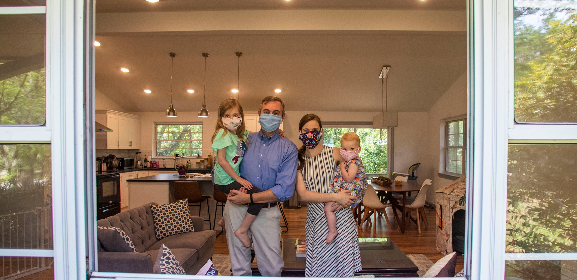 Leon County Commissioner Rick Minor, left, and his wife Jessica Lowe-Minor hold their two daughters Madeline, 6, and Charlotte, 1, as they wear masks that a friend made for them. When any of them leave the house, they ensure they are protected with their cloth face masks.