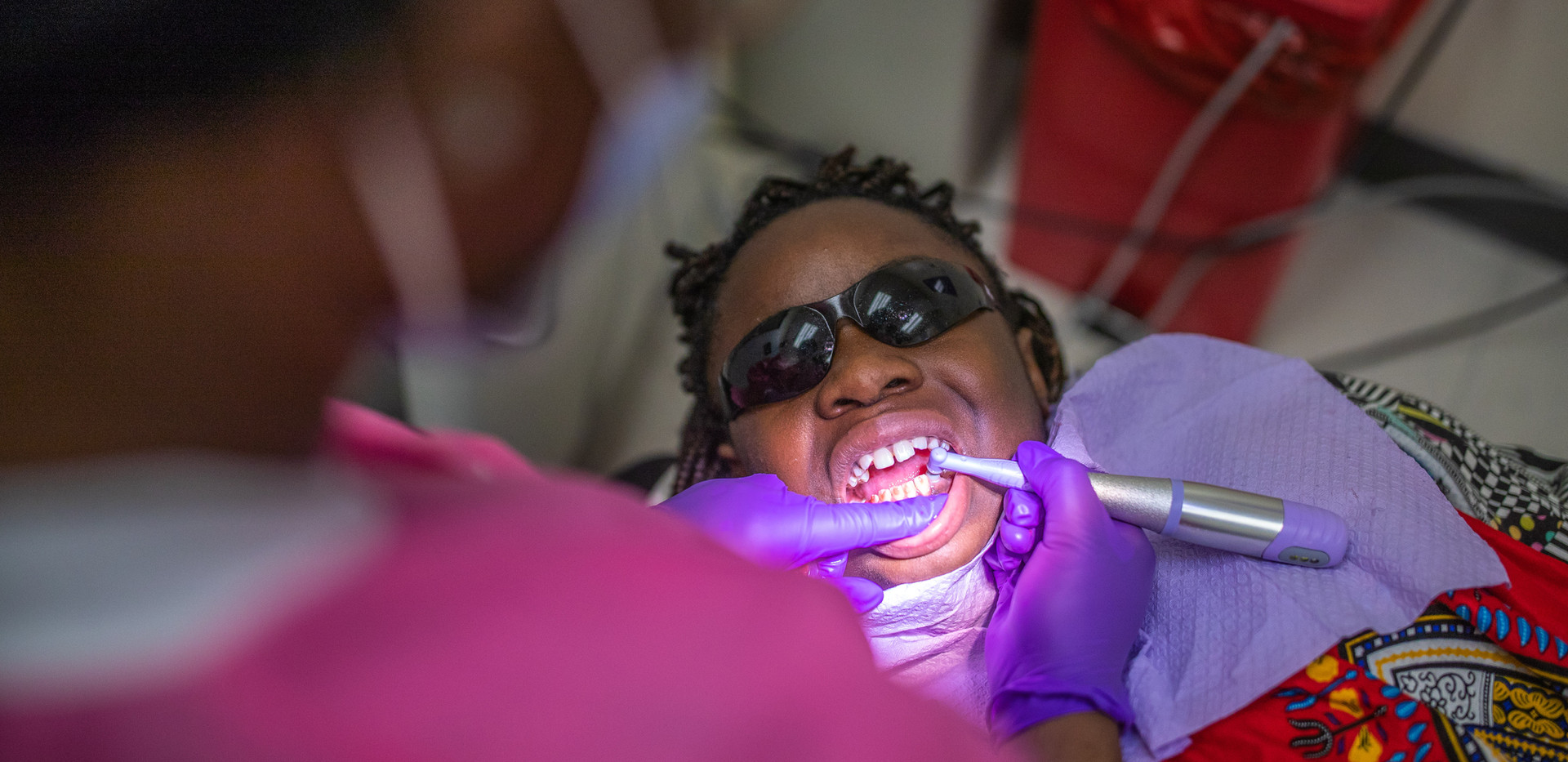 """A dental hygienist cleans Deitra """"DeeDee"""" Jackson's, 11, teeth during her appointment at a Neighborhood Medical Center."""