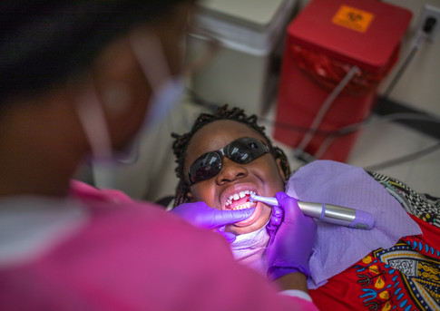 "A dental hygienist cleans Deitra ""DeeDee"" Jackson's, 11, teeth during her appointment at a Neighborhood Medical Center."