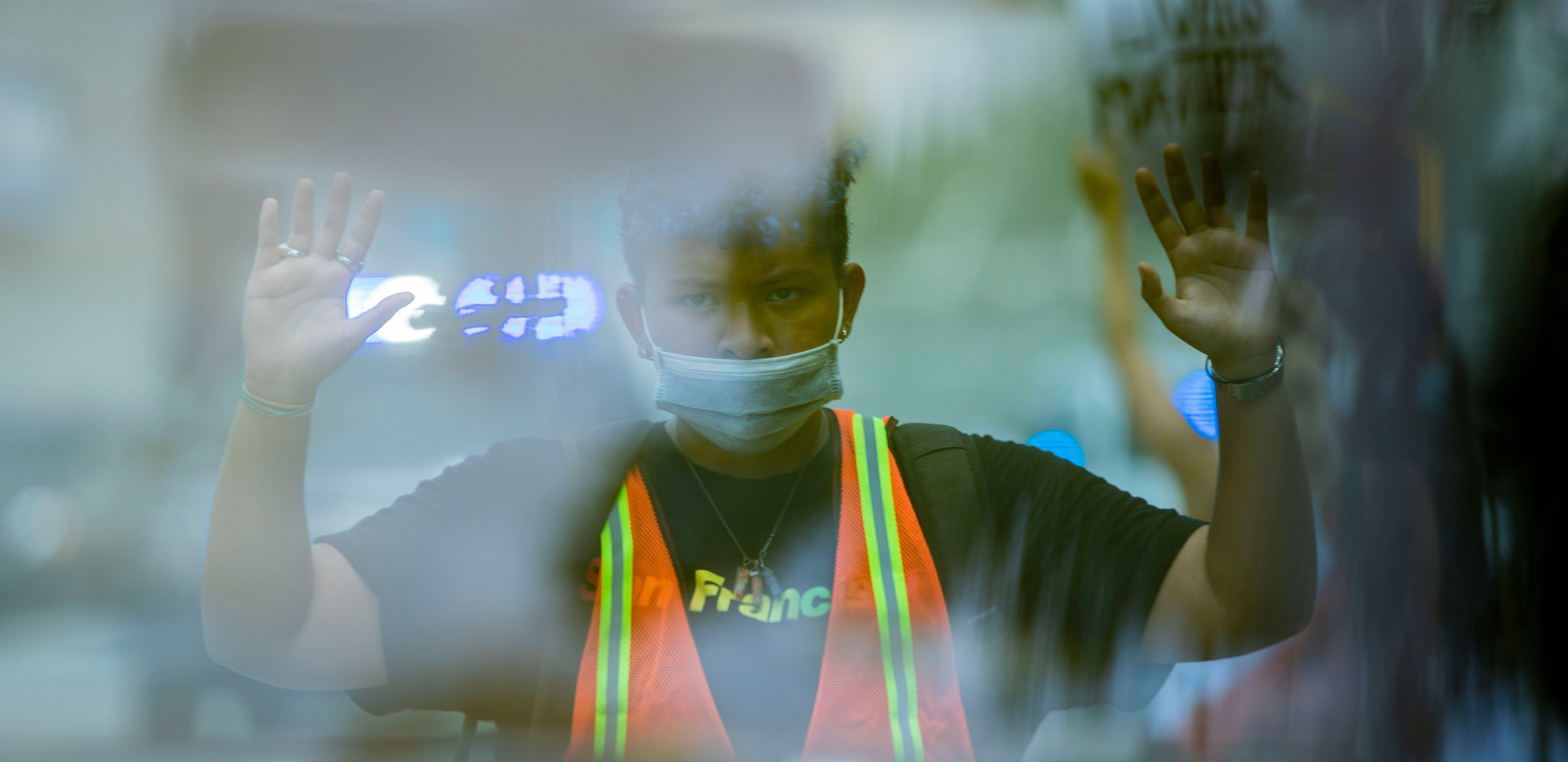 "Seen through the back window of a truck, Roman Le, 17, holds his hands and stares at the driver while protesters shout ""hands up, don't shoot,"" from the middle of Tennessee Street Thursday, July 9, 2020."