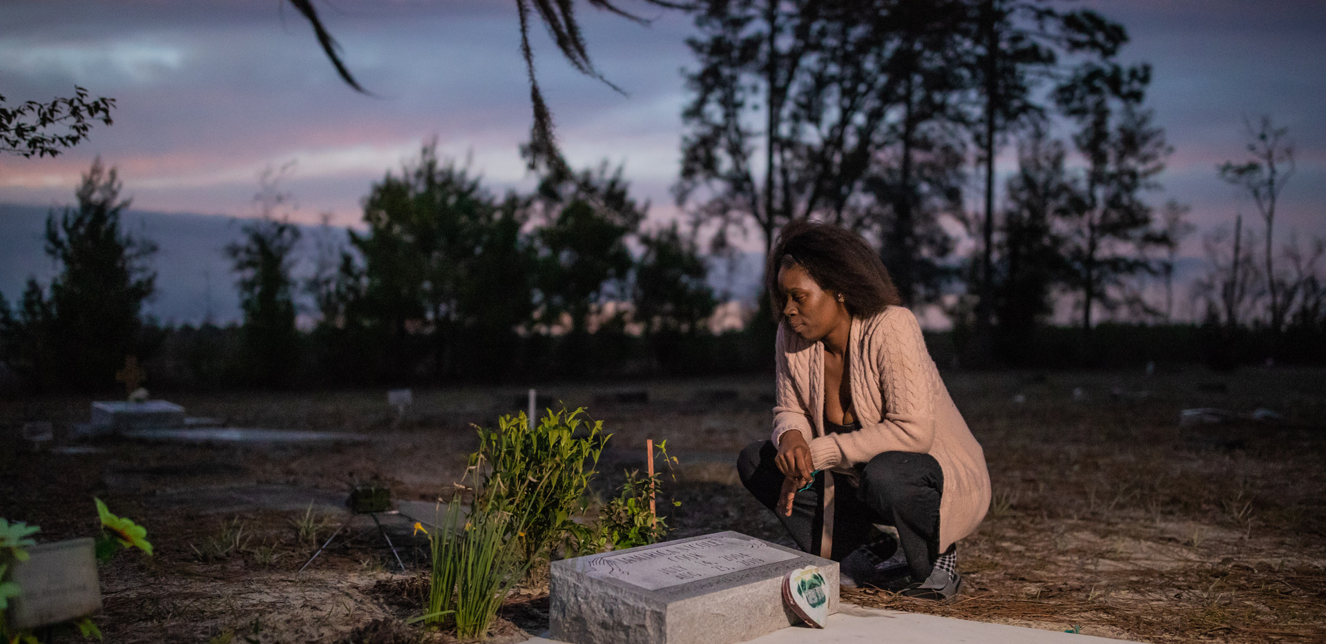 """Koquisha Cook, 36, spends time at her 15-years-old daughter's gravesite where she talks to her. Jamirica """"Noonie"""" Cook was shot and killed in their home in 2019."""