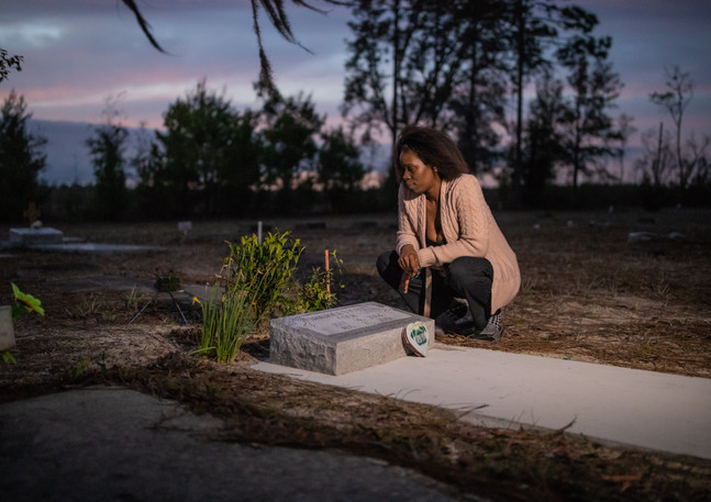 "Koquisha Cook, 36, spends time at her 15-years-old daughter's gravesite where she talks to her. Jamirica ""Noonie"" Cook was shot and killed in their home in 2019."