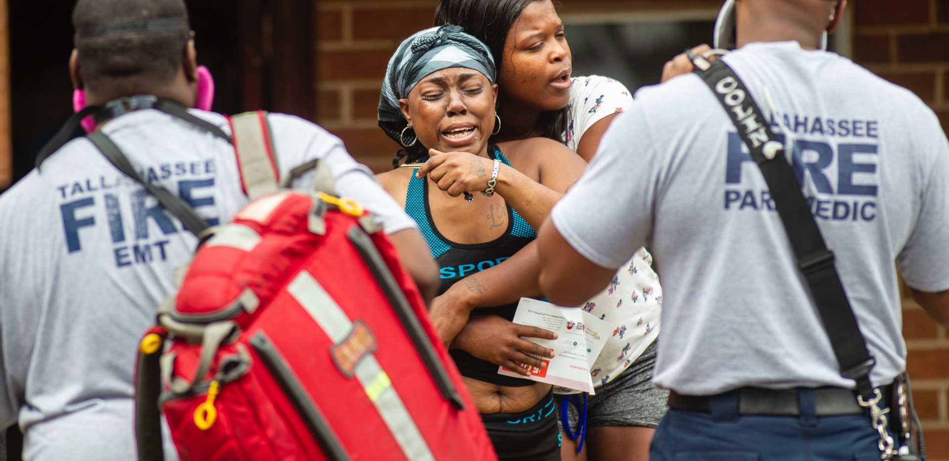 Jennifer Jackson sobs as she leaves a first floor apartment in the Holton Street apartment complex Wednesday, May 27, 2020. Jackson's son, Malik Jackson, 21, was stabbed and killed moments earlier.