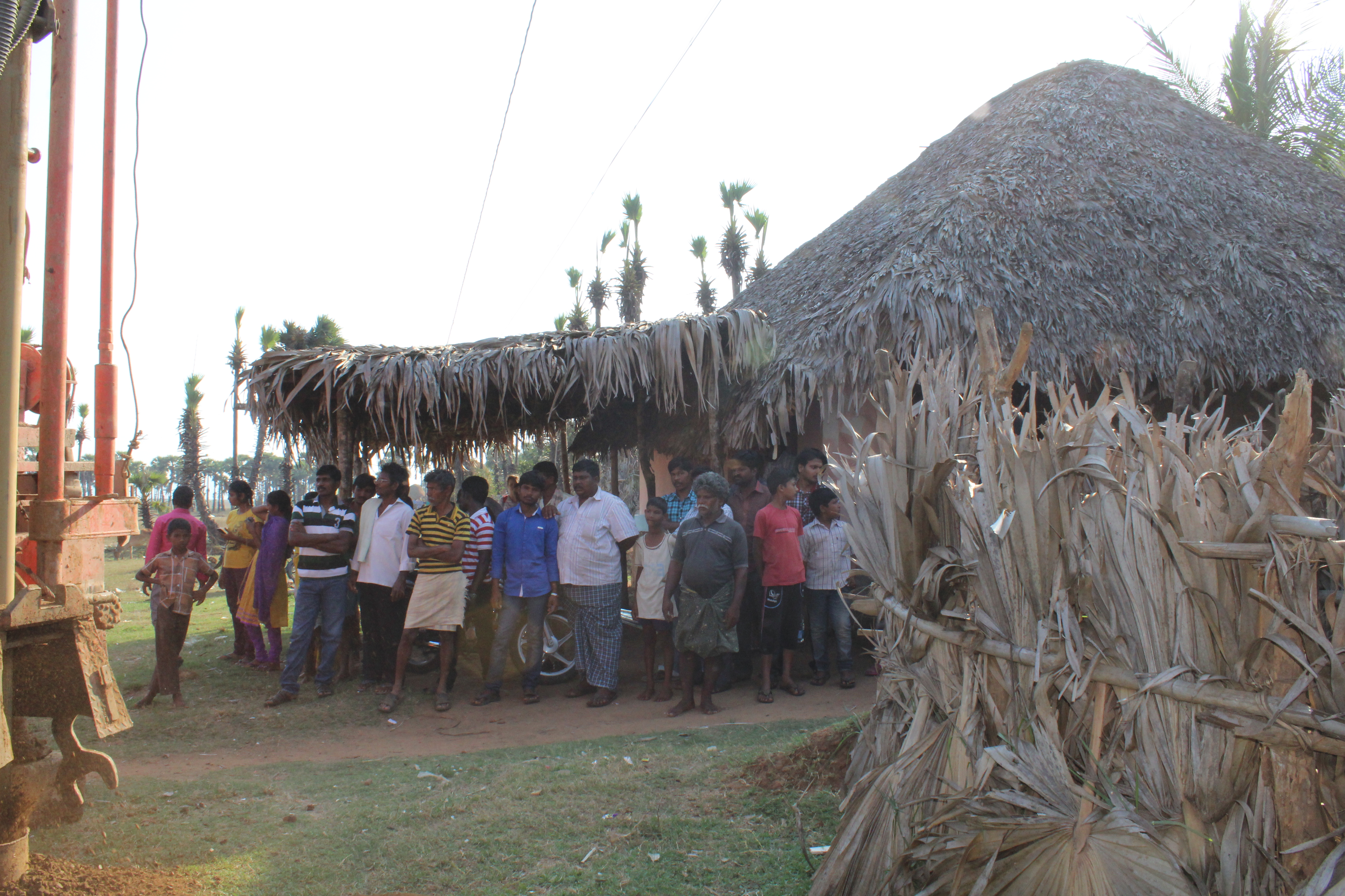 Villages gather to see the well.JPG