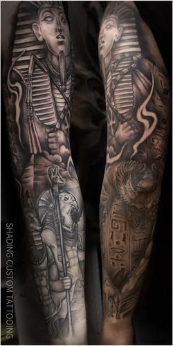 Black and grey egypt theme sleeve tattoo