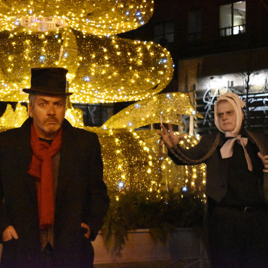 Ebenezer Scrooge (Mark Ellis) and Jacob Marley (Peter Churey)