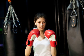 Woman and Boxing Bag.jpg