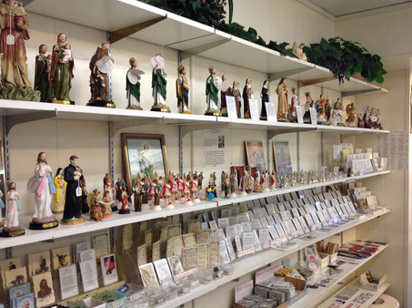Shelfs with cards and statues.jpg