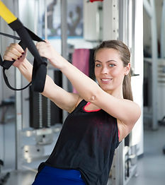 Woman and TRX Straps.jpg