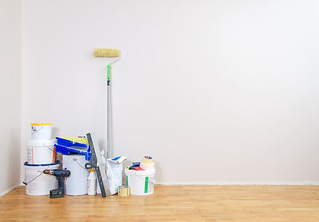Room repairs. Cans with paints, roller,