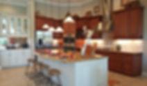 Two tone custom kitchen with large paneled island
