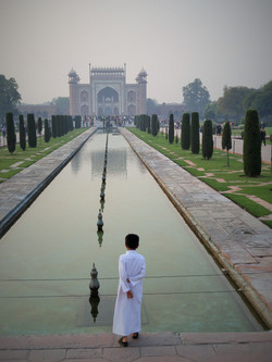 Boy at Taj Mahal pool.