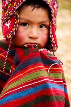 Child in Peruvian alpaca hat.