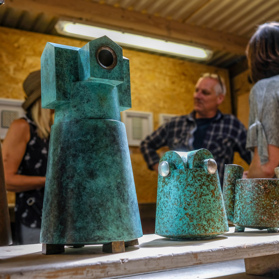Marcus chats with his visitors about his patinated metal pieces