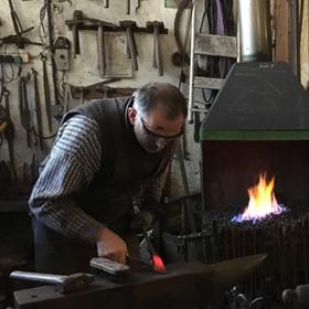 Village blacksmith David demonstrates his blacksmithing skills up at the forge