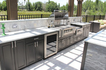 Black Werever Outdoor Cabinetry w/ Raised Backsplash Featuring an Upgraded Power Burner
