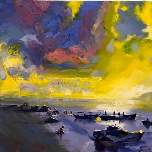 A traditional water scene turns powerful when massive cloud formations are presented in strong, contrary colors.