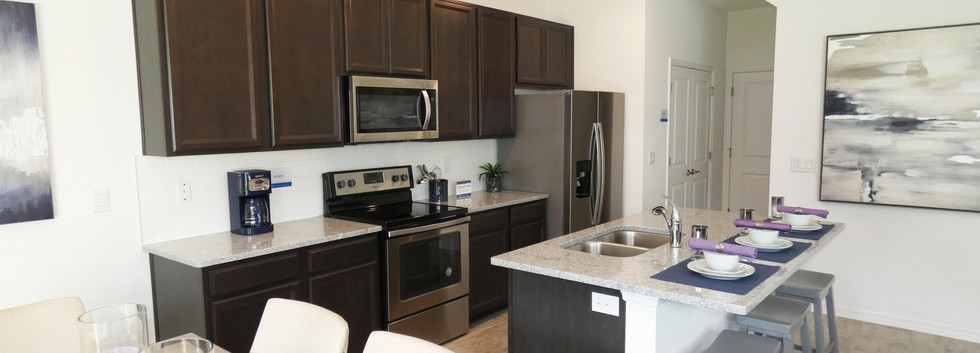 Open kitchen in Woodleaf Hammock town home