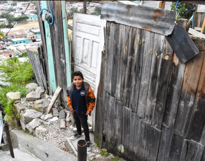 Rostyn standing in front of what was left of his house in the neighborhood of Feb. 21
