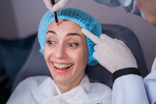 Relaxed, smiling woman during Botox treatment
