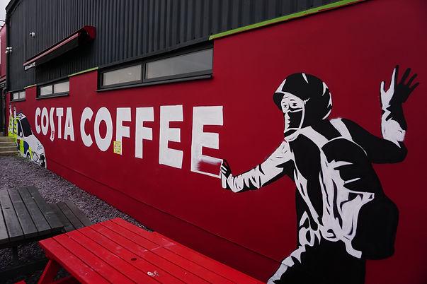 costa coffee banksy piece