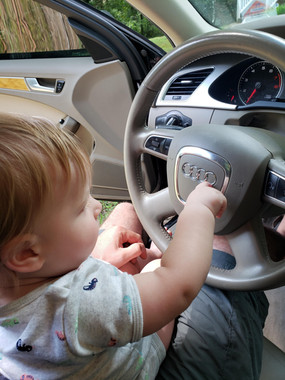 Little kid trying to drive an Audi A4 Avant
