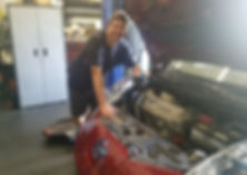 Nissan Leaf, a popular EV or electric vehicle, getting repaired with replacement of electric water pump