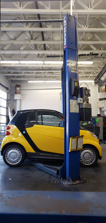 Smart car in the bay for automotive repair here in Raleigh, NC