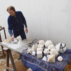 Carving the Platonic Solids in Stone