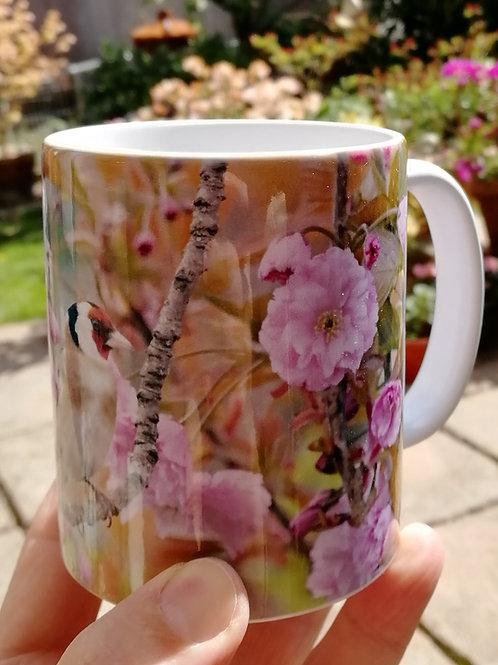 Goldfinch in cherry blossom mug