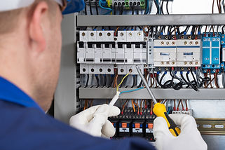 Male Technician Checking Fusebox.jpg