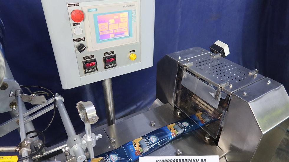 Автомат флоупак для упаковки брикетов творога
