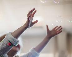 little-girl-catching-soap-bubbles.jpg