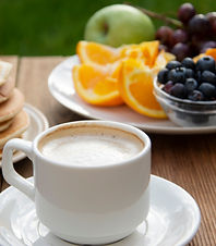 homemade-american-pancakes-with-cup-coffee-fruits-wooden-table_edited.jpg