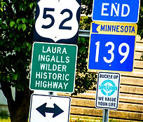 Image of Laura Ingalls Wilder Historic Highway, Minnesota Trunk Highway 139, and US Highway 52 Signs