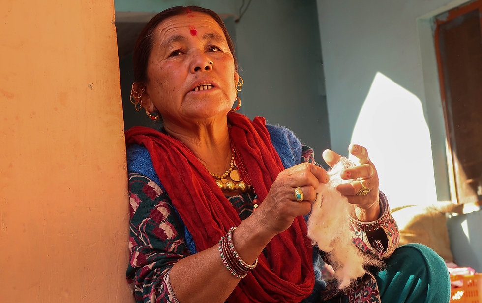 hand processing wool to make shawls and stoles by Bhotia ladies in the Himalayas