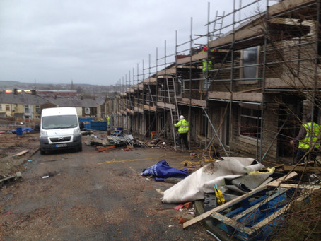 Scaffolding going up.Placefirst site up and running. SandBlasting and Stone Repointing.