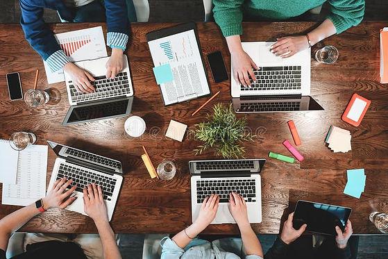 top-view-coworking-people-sitting-togeth