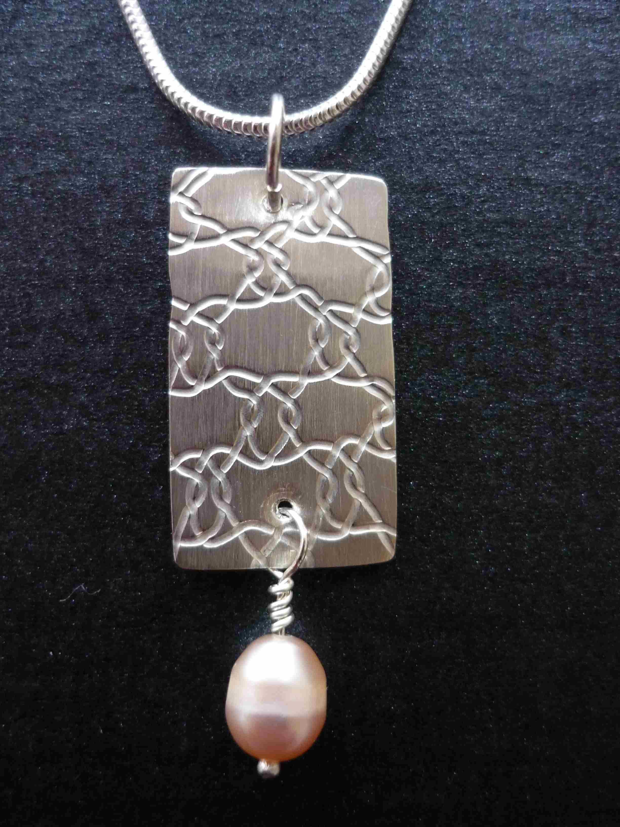Rollprinted silver pendant