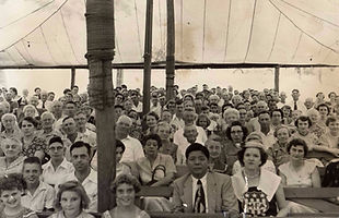 Campmeeting crowd under the tent in the 1960s