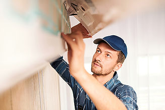 young-workman-workwear-looking-into-syst