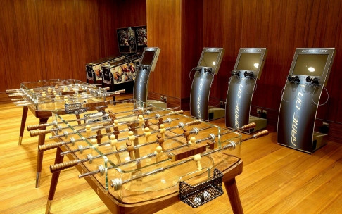 Travellers have access to entertainment in Qatar Airlines' Al Mourjan Business Class Lounge Game Room.