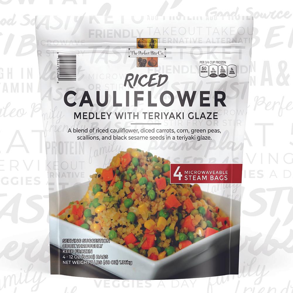 A blend of riced cauliflower, diced carrots, corn, green peas, scallions, and black sesame seeds in a teriyaki glaze.