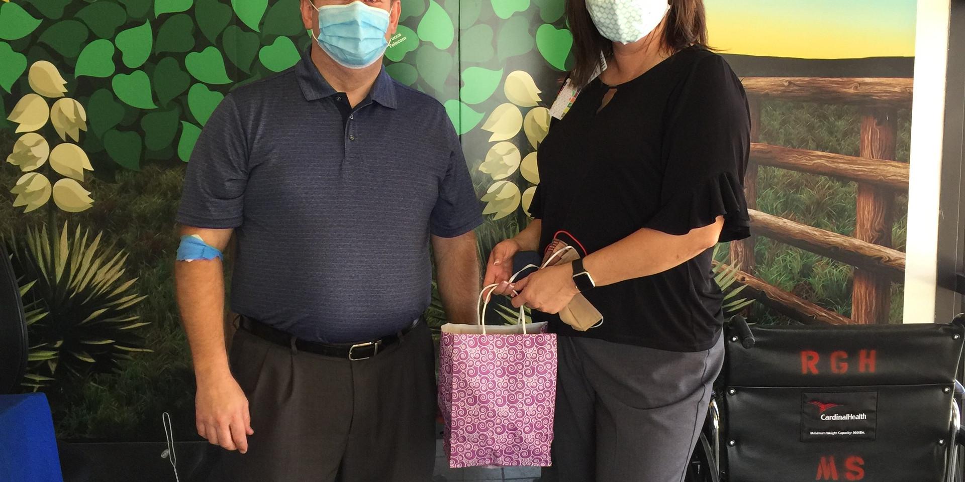 Stephen Stoddard, Executive Director of NMRHN delivering homemade mask donations to Roosevelt General Hospital on June 30, 2020.