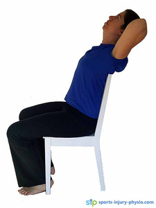Thoracic chair stretch - Extend your upper back by lifting from the breast bone.