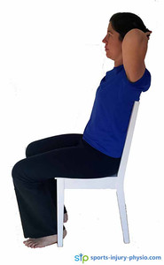 Tharacic stretch in chair - Place your hands behind your head.