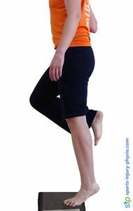 Single leg heel raise to strengthen the gastrocnemius calf muscle.