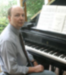 composer at the piano