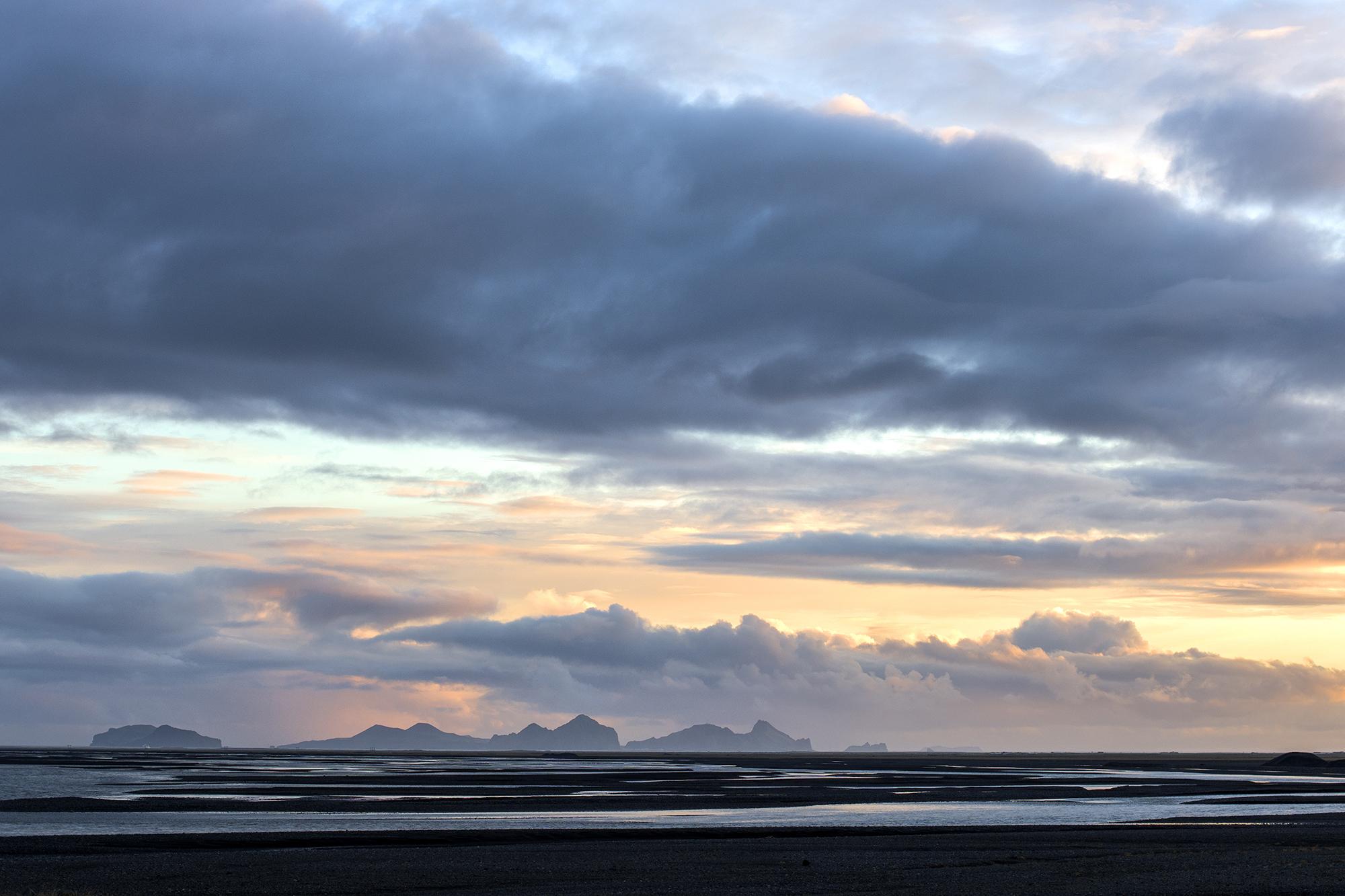 epic sunset over black sand beach